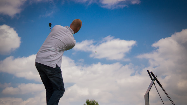 golfer hitting a golf ball